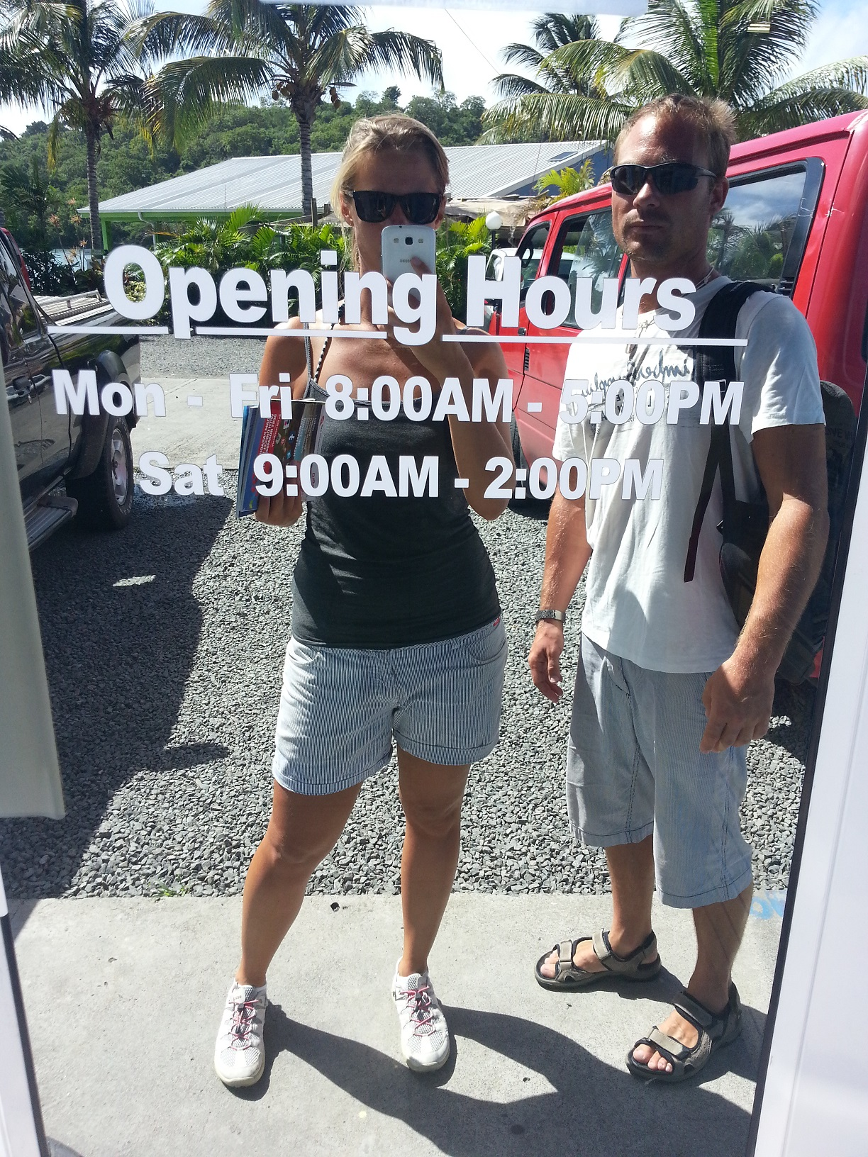 Salty sailors checking out the opening hours. When can we spend our money?